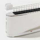 This super slender SG68 W stainless steel two-slice toaster by Stefano Giovannoni for Alessi with bun-warmer attachment will look great on your counter top (and won't take up too much of it).