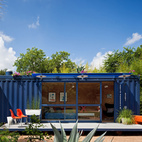 While shopping for containers, Hill was instantly drawn to this one's existing blue color and chose to buy it and leave it as is. Poteet added floor-to-ceiling sliding doors to allow light in, as well as a cantilevered overhang to shade a window on the left side, which houses a small garden storage area.  Photo by: Chris Cooper