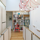 An artful string of Ikea lights brighten up remodeled Tutor home in Toronto, Canada.   Courtesy of: Copyright: Finn O'Hara