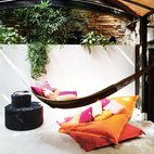 In architect Benedetta Tagliabue's flat in Barcelona, a lounge area, topped by a barrel ceiling and outfitted with a hammock offers a tantalizingly cozy place to nap. Photo by Gunnar Knechtel.  Photo by: Gunnar Knechtel