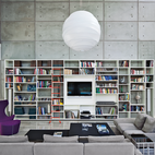 """""""All houses done by our office are designed around the library,"""" says Omer Dagan, an architect in Pitsou Kedem's eponymous Tel Aviv, Israel, firm. It's a boldly bibliophilic conceit, and an idea that makes an especially strong impact in Kedem's 2011 Haifa House. Photo by Amit Geron.  Photo by: Amit GeronCourtesy of: Amit Geron"""