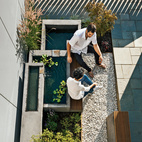 """""""In every project, we try to do one thing that's handmade, a custom design where the only way we could afford to do it is if we did it ourselves,"""" says architect Meejin Yoon. For a house Yoon designed for her parents in Arlington, Virginia, the handmade detail was a cast-concrete fountain located in a compact courtyard.  Photo by: Jeff Wolfram"""
