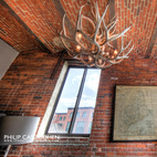 An antler chandelier hangs above the lobby waiting room.