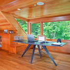 "Inbox only: Take a cue from this house in Maryland, in which the home office is dedicated to the world outside. The desk is unencumbered by drawers, and holds only a computer and an inbox. Nearby, wood cabinets and drawers hold ""cold storage."" Photo by James Ray Spahn.  Photo by James Ray Spahn.   This originally appeared in Rill Architects' Retreat in the Woods."