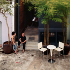 """Yang Yeo and his girlfriend Ching Ian relax on the back stoop of their renovated and radically updated Singapore shophouse—an archetypal building type in this busy port city. """"Shophouses brought back memories of our childhood,"""" says Yeo.  Photo by: Richard Powers"""