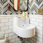 Playful wallpaper from Graham & Brown livens up the house's otherwise staid powder room, which also contains a pint-size Ikea sink.  Courtesy of ©Lincoln Barbour - All Rights Reserved.