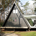 Adding 290 square feet to this already small (just 566 square feet) black A-frame in Brecht, Belgium, was all the local building ordinances allowed, but the architects at dmvA found that a single wing extended out to the side gave resident Rini van Beek all the storage and living space that she needs. Photo by Frederik Vercruysse.  Photo by: Frederik Vercruysse