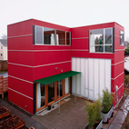 SeattleDavid Sarti's little red house in Seattle's sleepy Central District proves that a bit of land, ambition, and carpentry know-how can go a long way. The rear facade. Photo by Misha Gravenor.