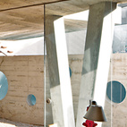 In this Material Focus installment, we examine béton brut—roughly finished exposed concrete—a modern design idea popularized by architects like Le Corbusier and Auguste Perret.For a family in Lima, a team from local firm 51-1 Arquitectos built Casa Serpiente, which meanders around 25 existing trees. Concrete is used extensively in the house, seen here on the ceiling of the office and walls of the pool. Lush foliage softens the rough-hewn surfaces. Photo by: Cristobal Palma