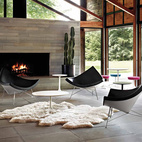Sheepskin rugs set off Herman Miller's Nelson Coconut Lounge chairs' sleek shape perfectly.