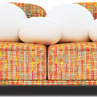The Cloud Sofa, designed by Marcel Wanders, is wrapped in a textured fabric and comes with white pillows that are designed to resemble clouds.    This originally appeared in Conversation Piece: 7 Statement Sofas.