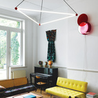 At another gallery/residence in Belgium, this time in a neoclassical Brussels mansion, two design-savvy curators have arranged their dream home... Only it's all for sale. In the living room, the residents commissioned the overhead light from designers Sylvain Willenz and Hubert Verstraeten. The rug is a Moroccan patchwork from the 1960s; the teak-and-leather Kilin chair is by Sergio Rodrigues; and the cane-backed sofa is a student daybed designed by Hans Wegner for Getama in the 1950s. Photo by Chris Tubbs.   Photo by: Chris Tubbs