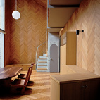 A distinctive wooden pattern lines the walls, floors, and ceilings of this compact home in Japan.