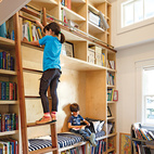 In this Boise, Idaho, family home, a transformed closet offers a comfortable space for readers of any size. The double-height library is homeowner Dan Zuckerman's favorite space. Photo by: Lincoln Barbour.  Photo by: Lincoln Barbour