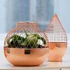 Jaime Hayon designed these copper vases for Gaia & Gino with an eye on Turkish geometric motifs. We love the shot of pure copper, especially when grouped as a trio.  Courtesy of Gaia & Gino.
