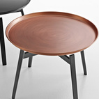 Unveiled at 2013 Salone del Mobile, the new Husk table by Patricia Urquiola for B&B Italia features a copper tray atop die-cast legs.  Courtesy of B&B Italia.