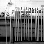 """Each cane weighs 369 grams and is handmade by folding and bending a piece of 3mm sheet aluminum. First, outlines and engravings are cut via CNC, then the upper end of each single sheet is bent by hand to form a hook-grip, while the lower part is folded 70° to enforce the main structure. """"V"""" engravings serve as cutting lines to customize the cane to each user's personal body measurements."""