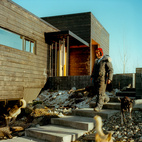 In the shadow of Mount McKinley, amid Alaska's meadows and icy streams, a former teacher and a four-time Iditarod winner built a modernist cabin with a charred-cedar facade as expansive as the Last Frontier. Photo by Kamil Bialous.  Photo by Kamil Bialous.   This originally appeared in Modernist L-Shaped Charred Cedar Cabin in Alaska.
