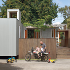 In the suburb on the mountain's lower slopes, Michael O'Sullivan and his sons Seamus and Finbar exchange motorcycle tips outside the compact, innovative home O'Sullivan designed.