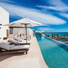 "The hotel's name ""El Ganzo"" translates to ""The Goose,"" reflecting the property's long, white exterior—which the lap-worthy infinity pool and glass-walled Jacuzzi sit atop. Your bird's-eye view: Puerto Los Cabos Marina, Sea of Cortez, and La Playita Beach."