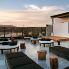 The rooftop bar is the perfect spot to sip an umbrella drink and watch live shows. But it's the raw materials and furniture like the recycled pinewood stage and log-style cocktail tables (all locally made) that snag the spotlight.