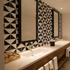 Inspired by old-world Mexican ceramics, artist José Noe Suro in collaboration with Mary Alice Palmer and Natalie Smith designed the bathrooms' black and white geometric mosaics.