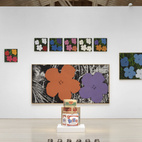 From Warhol's famous hyper-color prints of hibiscus flowers (background), to his little known (unreleased) perfume collaboration (contained within the silver Coke bottles in front).Credit Stefan Altenburger, Courtesy The Brant Foundation