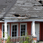 An derelict abandon house once sat on the plot of land. Here's what it looked like before. With the help of locals, artist Matthew Mazzotta demolished the house, saving materials where he could. Once everything that could be salvaged was set aside, the fire department burned the remainder.
