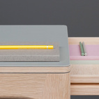 """Graft Desk: """"The Graft desks' understated appearance defies it's practical potential for use in a variety of environments. The effortless oak framework, with two concealed drawers, is balanced perfectly alongside the warmth and practicality of the uncluttered desk top linoleum surface,"""" says Welsh."""" ($2,627)"""