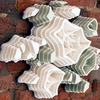 Jami: Hand-Cut Paper Clusters by Charles ClaryA meticulous creation by Tennessee-based artist, Charles Clary who has combined design and patience to sculpt these fascinating and beautiful varying paper formations.