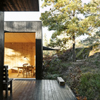 "The house is divided into three sections connected by a series of outdoor galleries. ""When I walk from one room to another, I have to go outdoors and feel the weather and nature—rain, cold, and sun,"" says Sævik.  Instead of emphasizing the expansive panorama of oak, pine, and aspen trees, the house frames select views—a move inspired by Japanese design.  Courtesy of Ivan Brodey ."