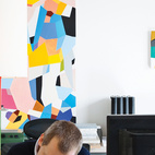 PLAYFUL FAMILY HOME IN BELGIUM A pair of interior architects with a years-in-the-making furniture collection recast an old Belgian factory as a playful family home. Interior architect and resident Renaud de Poorter works in his second-floor office at a pair of Joyn tables by the Bouroullec brothers and an Ypsilon office chair by Mario Bellini for Vitra. Photo by Frederik Vercruysse.