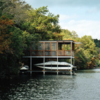 Designed as a prefabricated monolithic steel grid, this Texas boathouse's orthogonal frame was delivered from Houston by truck and then transported by barge to the site. But the structure does more than house a boat. Just 400 square feet on each level and furnished with comfy chairs, it's both a playhouse and a retreat—and it's off the grid. Photo by Paul Bardagjy.  Photo by Paul Bardagjy .   This originally appeared in A Prefab Boathouse in Texas .