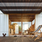 Sliding glass doors made from Viridian's ComfortPlus glass and yellow cedar wood lead to decks flanking the kitchen and dining room.  Photo by: Simon DevittCourtesy of: Simon Devitt
