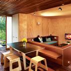 Designer Tim Webber created the dining table and stools.  Photo by: Simon DevittCourtesy of: Simon Devitt