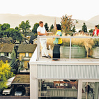 A Vancouver architect maxes out a commercial lot to create a multiunit prefab tower that takes smart urban planning as seriously as good design. Each of the residences has outdoor space attached to it; the family's unit has a roof deck. In lieu of a green roof is a galvanized tub filled with grasses—a collaboration between the architects and landscape architecture firm space2place. Photo by Kamil Bialous.  Photo by Kamil Bialous.