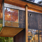 AN ECO-FRIENDLY COMPACT CABIN IN WASHINGTON On Puget Sound, activist and filmmaker Anna Hoover collaborated with Les Eerkes, a principal at Olson Kundig Architects, on a 693-square-foot studio in the woods. Using freecycled materials and a six-footed foundation to rein in construction costs, Hoover and Eerkes created a distinctive structure that treads lightly on the land.Photo by Benjamin Benschneider.  Photo by Benjamin Benschneider.   This originally appeared in An Eco-Friendly Compact Cabin in Washington.