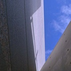 In this shot, the promise of the emerging structure is clearly visible: intersecting granite and concrete walls demonstrate the harmonious triumverate of sky, stone and concrete.  Courtesy of: Richard Pare