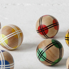 These hand painted wooden balls make Bocce, a game with roots going all the way back to the Roman Empire, an excellent contemporary pastime for children and adults alike. Photo courtesy of Fredericks & Mae.  Courtesy of: Fredericks & Mae