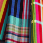 The large-repeat stripes and grids are inspired in part by Bauhaus textile artist Anni Albersand in part by Wallace Sewell'sLondon neighborhood.