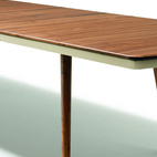 The Red Dot Award–winning Flaye table by Jacob Strobel—for Austrian manufacturer Team 7—features a solid-wood top and leather detailing plus a sophisticated butterfly-leaf mechanism that extends its length by 39 inches in an effortless, streamlined motion.