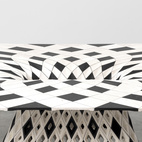 Laarman's Diamond table from his Maker Series. Engineered to function like a three-dimensional puzzle, the series features chairs and tables made in tiny, interlocking pieces of resin, wood, plastic, or metal. Photo by Andrew Bovasso; courtesy of Friedman Benda and Joris Laarman.