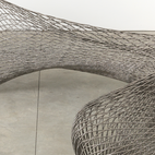 The molten stainless steel parts of the Dragon bench are printed mid-air using the MX3D printer that Laarman created. Photo by Andrew Bovasso; courtesy of Friedman Benda and Joris Laarman.
