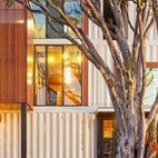 Shipping Container Home (Brisbane, Australia) Architect and designer Todd Miller didn't just use a shipping container for this home—it appears like he used an entire shipping company, since it took 31 containers to build this industrial but inviting home, which features a massive graffiti mural on the back wall.  Photo by ZieglerBuild