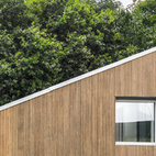WFH House (Wuxi, China) Copenhagen-based Arcgency made something special out of a rigid skeleton of shipping containers—a gorgeous, bamboo-clad modular home that offers stylish customization options and environmental features (solar cells, water cistern, green roof) that push this project beyond mere recycling.  Photo by Arcgenvy