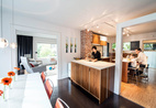 Architects Sara and Jeremy Imhoff and their son Jonah use the renovated kitchen in their 1918 bungalow in Seattle's Fremont neighborhood.  Courtesy of Miguel Edwards Photography.