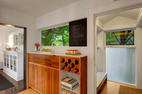 The Imhoffs designed the custom wine rack, which was built by KERF Design of Seattle. They enclosed an old side porch off the kitchen, transforming it into a mudroom.  Courtesy of Aaron Leitz.