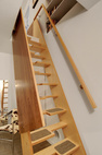 There was no room in the 2,000-square-foot house for a staircase to a new upstairs office, so the Imhoffs installed a small, wooden alternating-tred lapeyre stair.  Courtesy of Aaron Leitz.