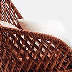 Ahnda chair by Stephen Burks for Dedon. Latticed red, orange, and brown textile cord make up the sides and back of the indoor-outdoor lounge chair.