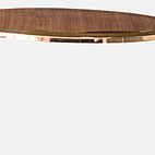 Majordome tables by Cédric Ragot for Roche Bobois. A chromed-steel frame finished in brass or gold supports walnut-veneered MDF tops. Available in four different bases, including the Pied X Double Plateau.